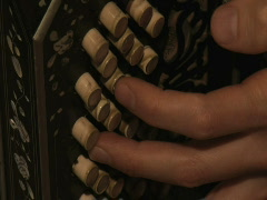 Close up of musician's fingers playing bandoneón - stock footage