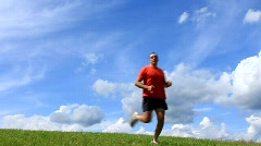 Runner in red t-shirt Stock Footage
