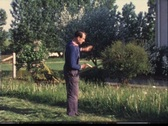 Man cutting grass with scythe (vintage 8 mm amateur film) Stock Footage
