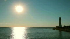 Old lighthouse at sunset Stock Footage