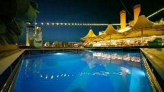 Outdoor swimming pool in night cruise ship Stock Footage