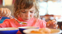 Portrait of eating little girl Stock Footage