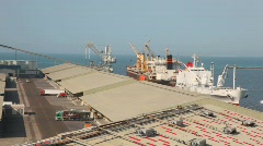 Trucks and ship in seaport in Abu Dhabi, UAE Stock Footage