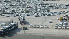 Stock Video Footage of automobile transporters with new cars leaves parking