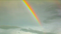 Powerful rainbow segment in the clouds. - stock footage