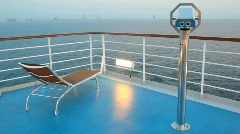 Deck chair and stationary binocular on cruise ship Stock Footage