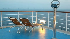 Deck chairs and binocular on moving cruise ship Stock Footage
