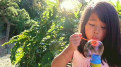 Child Little Girl Blowing Bubbles Stock Footage