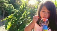 Stock Video Footage of Child Little Girl Blowing Bubbles