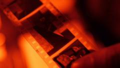 Film development photo in the laboratory with red light Stock Footage