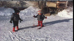 Little children on ski in the 1960s (vintage 8 mm amateur film) Stock Footage