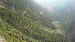 Aerial, flight over forest steep valley Stock Footage