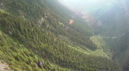 Stock Video Footage of aerial, flight over forest steep valley