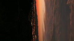 HD Vertical 1 - Dusk timelapse of desert red skies and moving traffic lights Stock Footage