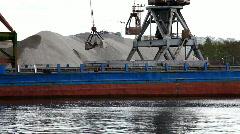Shipboard crane loaded sand Stock Footage