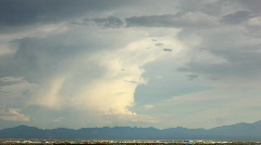 HD - Thunderhead converts to gigantic lenticular and spreads over mountains Stock Footage