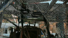 Used fishermans net hanging off a harbored boat slightly swaying HD Stock Footage