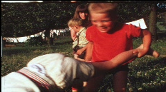 Children playing shuttlecock (vintage 8 mm amateur film) Stock Footage
