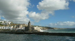 Time lapse white clouds over Porthleven in Cornwall UK. Stock Footage