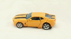 The toy car is transformed in the transformer robot Stock Footage