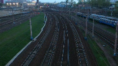 Electric trains moves on rails, springs evening. Stock Footage