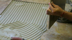 Tile setter, flooring, a Stock Footage