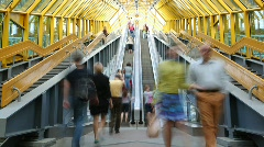 People rise and fall on the escalator in footbridge. Stock Footage