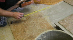 Tile setter measuring g Stock Footage