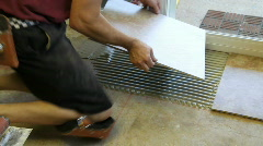 Tile setter placing tile, p Stock Footage