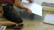 Tile setter placing tile, p Stock Footage