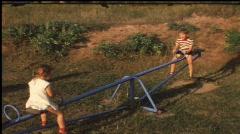 Children on swing (vintage 8 mm amateur film) Stock Footage