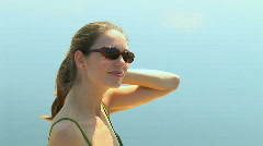Head and shoulder portrait of young woman in swimsuit enjoying the sun Stock Footage