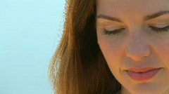 Portrait of young woman outside with wind blowing Stock Footage