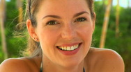 Casual close up portrait of young woman smiling outside Stock Footage