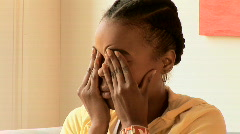 Close up of African American woman rubbing forehead - stock footage