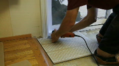 Tile setter sawing Stock Footage
