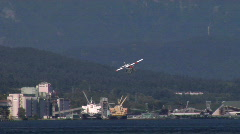 Red White Float Plane Lands Stock Footage