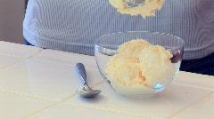 Woman making ice cream sundae - stock footage