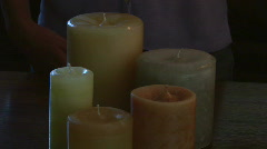 Woman lighting candles Stock Footage