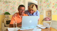 Mature couple using laptop Stock Footage