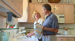 Mature couple doing dishes Stock Footage