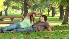Young couple being affectionate in a park - stock footage