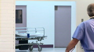 Medical personnel in hospital corridor Stock Footage