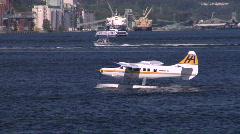 Yellow White Float Plane Takes Off Stock Footage