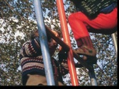 Stock Video Footage of Children climbing monkey bars (vintage 8 mm amateur film)