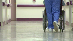 Medical personnel and patient - stock footage