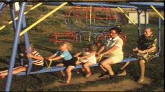 Grandma, mother and children on swingboat (vintage 8 mm amateur film) Stock Footage
