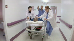 Medical personnel in hospital with patient Stock Footage
