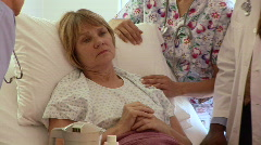 Medical personnel in hospital with patient - stock footage