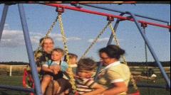 Grandma, mother and children in swingboat (vintage 8 mm amateur film) Stock Footage